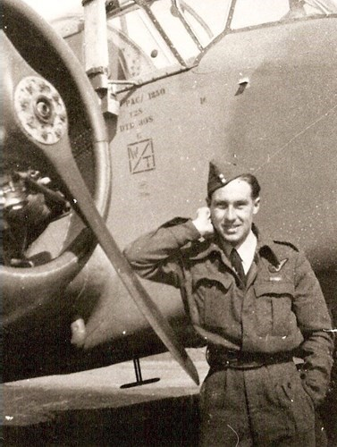 Peter Rackliff standing next to A Halifax V bomber