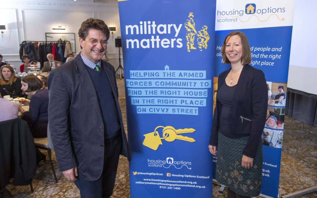 Veterans foundation ceo posing with member of charity